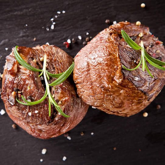 bigstock-Pieces-of-red-meat-steaks-with-60619070